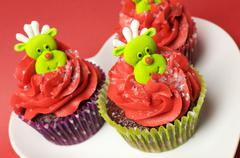 Christmas cupcakes with fun and quirky reindeer face toppings in modern and f Stock Photos