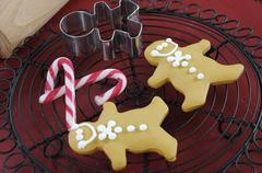 Christmas holiday festive baking with gingerbread men cookies and cookie cutt Stock Photos