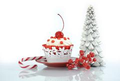 Happy Christmas red velvet cupcake with cherry and tree on reflective white b Stock Photos