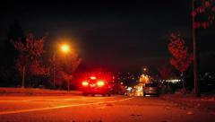 Cars Drive Down Hill In City At Night Stock Footage