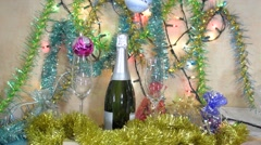 Christmas Decoration - a Bottle of Champagne, glasses, balls and tinsel - stock footage