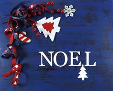 Christmas holiday festive natural style wood and felt ornaments on a dark roy Stock Photos