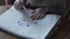 The girl paints nails a felt-tip pen - stock footage