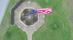 Top view / interesting angle of large USA flag blowing in wind - stock footage