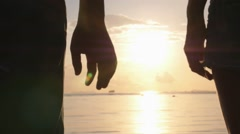 Romantic Couple Holding Hands on Beach at Sunset Arkistovideo