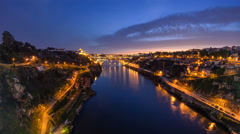 Day to Night view of the historic city of Porto, Portugal timelapse with the Dom Stock Footage