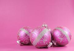 Beautiful fuchsia pink festive bauble ornaments on a feminine pink background Stock Photos