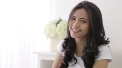 Happy young asian woman smiling to the camera Stock Footage