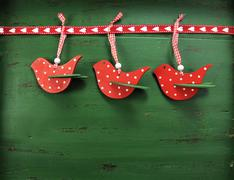 Christmas holiday background with red, white, festive polka dot birds against - stock photo