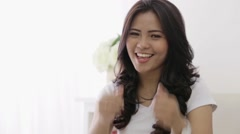young asian woman showing thumb up - stock footage