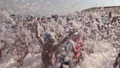 Happy children at day foam music disco beach party. Slow motion Stock Footage