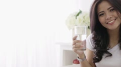 Woman having a drink Stock Footage