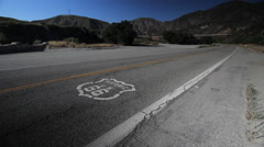 Route 66 road with highway logo car passing Stock Footage