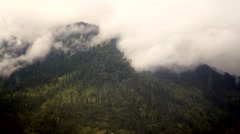 Smoke on the Mountain Forest (Clouds time-lapse motion in the Sky) - stock footage