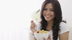 Woman having a bowl of fruit salad Stock Footage