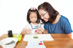 Mother teach daughter to painting - stock photo