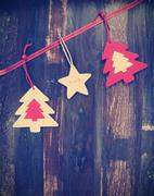 Christmas holiday background on dark recycled wood with festive hanging felt  Stock Photos