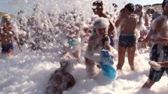 Happy people at day foam music disco beach party. Slow motion Stock Footage