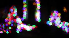Christmas lights outside defocused Stock Footage