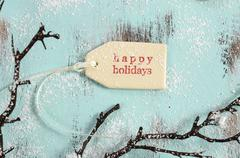 Merry Christmas festive baking concept with closeup on happy holidays gift ta Stock Photos