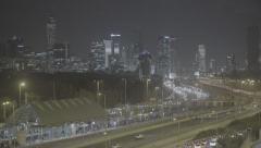 Highway for Tel Aviv night skyline with defocus SLOG3 Stock Footage