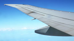 4K Traveling by Airplane at Daylight. View From Airplane Window Stock Footage
