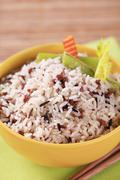 Bowl of mixed rice and wooden chopsticks - stock photo
