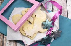 Baking homemade Christmas shortbread cookie biscuits in reindeer, bells, sant Stock Photos