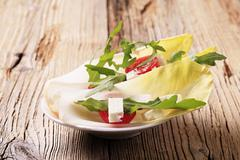 Endive leaves, arugula and diced feta cheese Stock Photos
