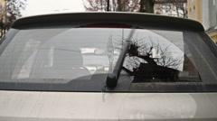 Rear window screen windshield wipers in motion Stock Footage