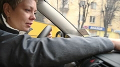 Woman driver programming the GPS navigator in car Stock Footage