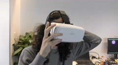 A man watches a demonstration of virtual reality movie game Stock Footage
