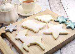 Homemade Christmas shortbread biscuit cookies in reindeer and festive shapes  Stock Photos