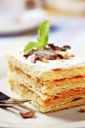 Mille-feuille pastry dusted with powdered sugar Stock Photos