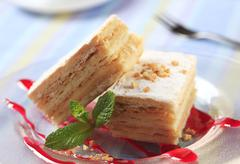 Slices of apple mille-feuille cake dusted with powdered sugar Stock Photos