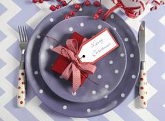 Bright colorful modern Christmas children family party table place settings i - stock photo