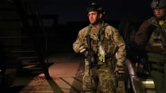 Man in military camouflage listens to briefing before night mission (HD) Stock Footage