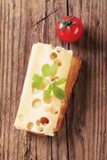 Slice of Emmentaler cheese on toast - overhead Stock Photos