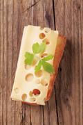 Thin slice of Emmentaler cheese on toast - stock photo