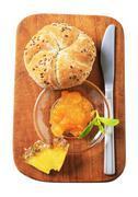 Whole grain kaiser roll with marmalade Stock Photos