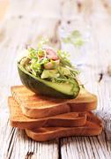 Avocado salad and toasted bread - closeup Stock Photos