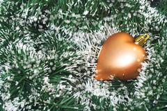 Christmas toys golden color in tinsel - stock photo