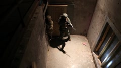 Men in antiterrorism training drill clear a room at night (HD) Stock Footage