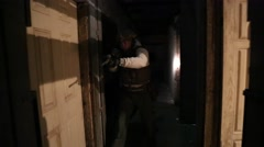 Men in antiterrorism drill clearing dark hallway with flashlights (HD) Stock Footage