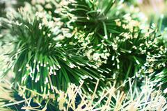 Natural background of Christmas tinsel with different blur the focus on the l Stock Photos