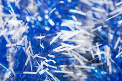 Natural background of Christmas tinsel with different blur the focus on the l - stock photo
