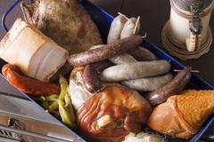 Variety of meat products in a baking pan Stock Photos