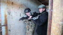 Men clearing rooms in the daytime during antiterrorism training (HD) Stock Footage