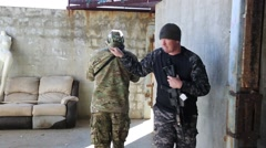 Two men clear a courtyard for antiterrorism training - stock footage