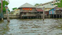 Old houses on the river bank Stock Footage